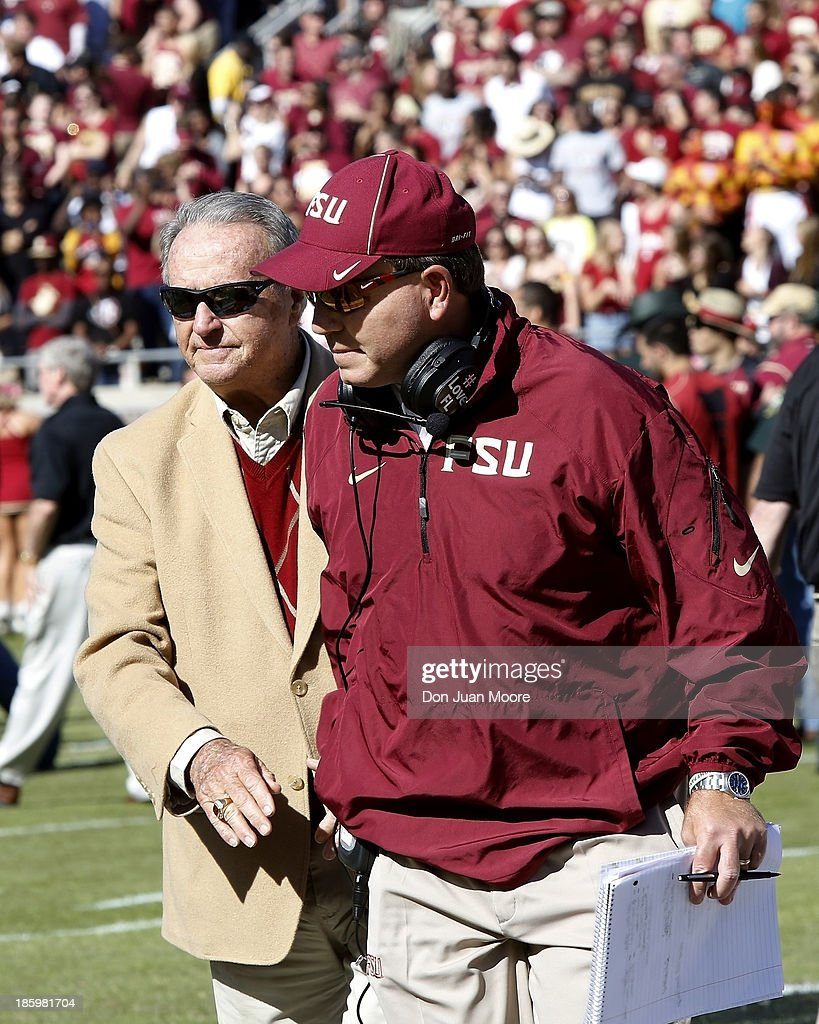 Former Florida State Head Coach Bobby Bowden (L) and Head Coach Jimbo Fisher finish a ceremony before the game against North Carolina State Wolfpack at Bobby Bowden Field at Doak Campbell Stadium on October 26, 2013 in Tallahassee, Florida. Bowden, who coached the Seminoles from 1976-2009 is the all-time leader in coaching victories in FBS with 377 wins. The 3rd ranked Florida State Seminoles defeated North Carolina State Wolfpack 49-17.
