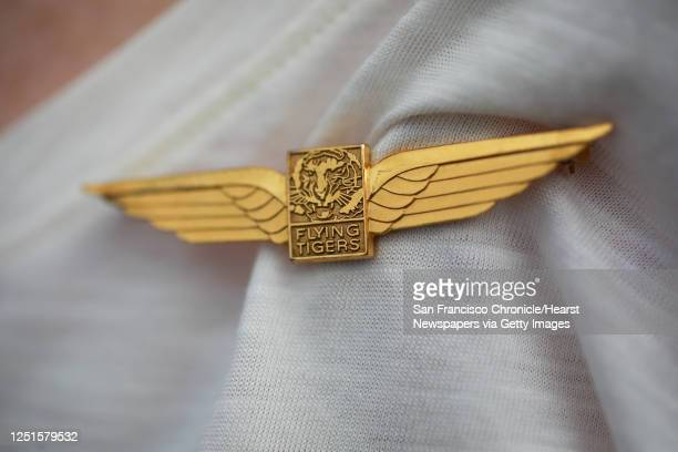 Former Flying Tigers flight attendant Joan Arthur shows off the pin she wore as a flight attendant in San Francisco, Calif., on Wednesday, Sept. 18,...