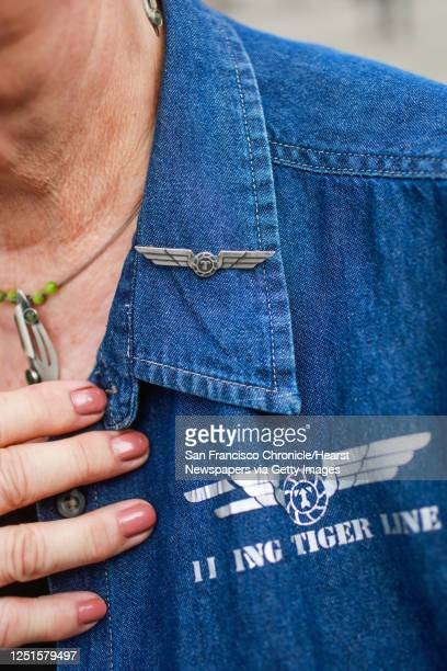 Former Flying Tigers flight attendant Marilyn Breen shows off a shirt and the pin she wore as a flight attendant in San Francisco, Calif., on...