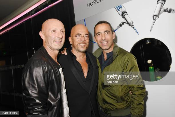 Former football champion Fabien Barthez singer Pascal Osbipo and former football champion Youri Djorkaeff attend the HYT Watches Launch Party at VIP...