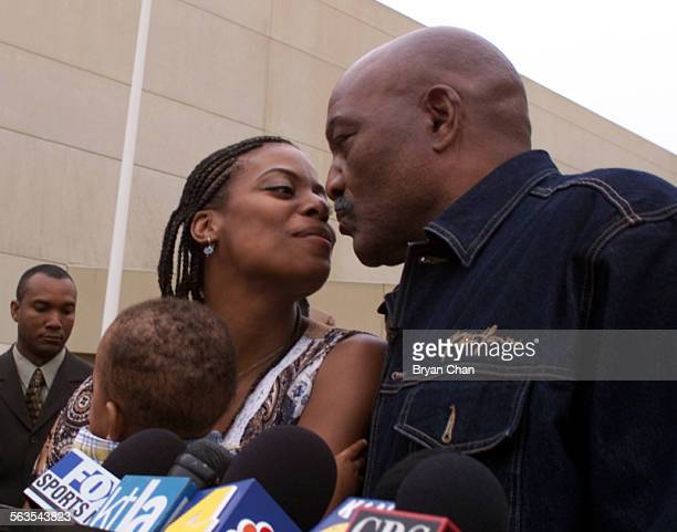 Former football great Jim Brown, right, kisses his wife Monique after leaving Ventura County jail Wednesday. He served time instead of going to anger...