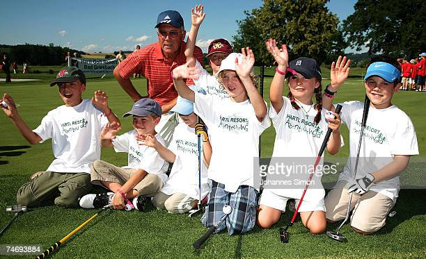 Former football legend Franz Beckenbauer poses with children during the opening of Hartl Golf resort on June 17 in Penning Germany