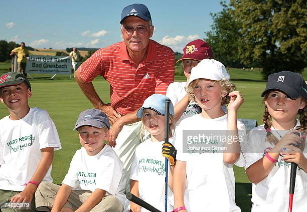 Former football legend Franz Beckenbauer poses with children during the opening of Hartl Golf resort June 17 2007 in Penning Germany