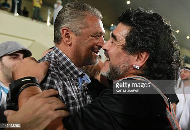 Former football player Alessandro Altobelli meets with Argentine football legend Diego Maradona coach of UAE's AlWasl after Maradona's team won their...