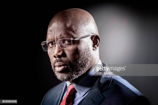 Former football player and candidate in Liberia's presidential elections George Weah poses during a photo session on September 25 2017 in Paris / AFP...
