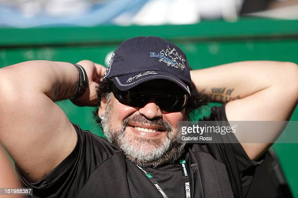 Former football player and coach Diego Armando Maradona enjoys the second Davis Cup semi-final match between Monaco and Berdych of Argentina and...