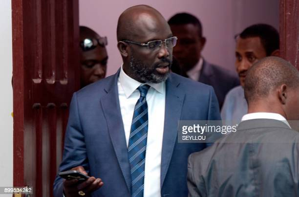 Former football player and winner of Liberia's presidential elections George Weah leaves after a meeting at the offices of his party's headquarters...