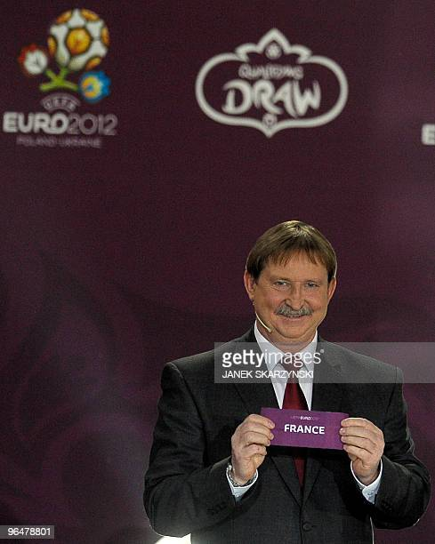 Former football player Andrzej Szarmach from Poland shows a ticket marked 'France' taken in a draw during the ceremony for the qualifying games of...