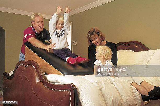 Former football player Boomer Esiason is photographed with wife Cheryl son Gunnar and daughter Sydney for Sports Illustrated on September 20 1993 in...