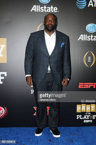 Former football player Brentson Buckner poses on the blue carpet during the Allstate Party At The Playoff on January 7 2017 in Tampa Florida