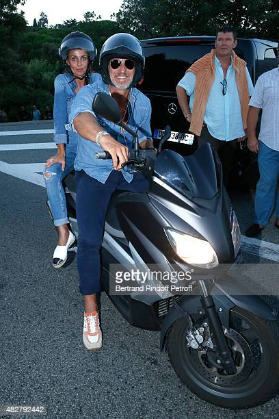 Former Football player David Ginola and his wife Coraline arrive in Scooter at the 'Madame Foresti' show of Humorist Florence Foresti during the 31th...