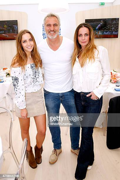 Former Football player David Ginola standing between his wife Coraline and their daughter Carla attend the 2015 Roland Garros French Tennis Open Day...