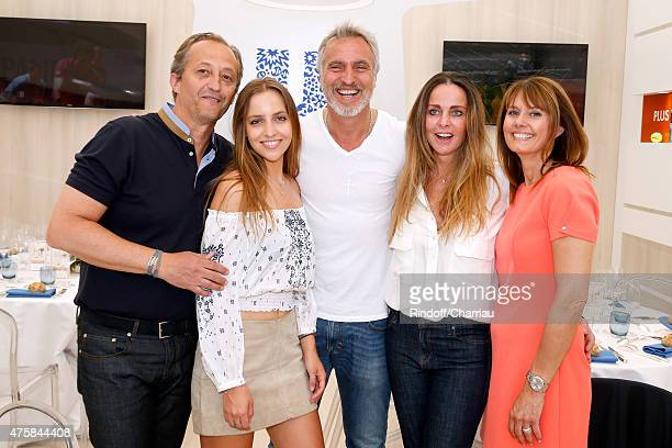 Former Football player David Ginola standing between his wife Coraline , their daughter Carla , Director of Group Stores 'Unilever', Hubert Rivet and...