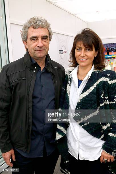 Former Football Player Dominique Rocheteau and his wife Laurence attend the 2015 Roland Garros French Tennis Open Day Eight on May 31 2015 in Paris...