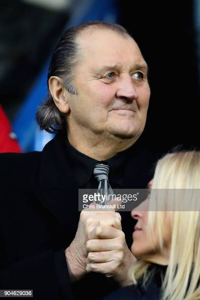 Former football player Frank Worthington looks on from the stands during the Premier League match between Huddersfield Town and West Ham United at...