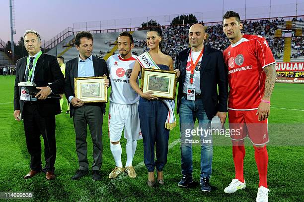 """Former football player Hidetoshi Nakata and Marco Materazzi pose for photographs prior to the charity match """"Perugia Per Sendai"""" at Renato Curi..."""