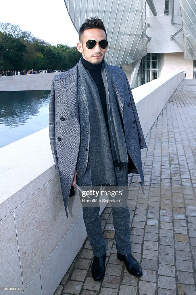 Former Football Player Hidetoshi Nakata attends the Louis Vuitton show as part of the Paris Fashion Week Womenswear Spring/Summer 2016. Held at Fondation Louis Vuitton on October 7, 2015 in Paris, France.