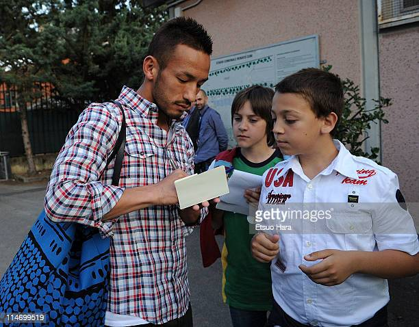"""Former football player Hidetoshi Nakata signs autographs for fans prior to the charity match """"Perugia Per Sendai"""" at Renato Curi Stadium on May 23,..."""