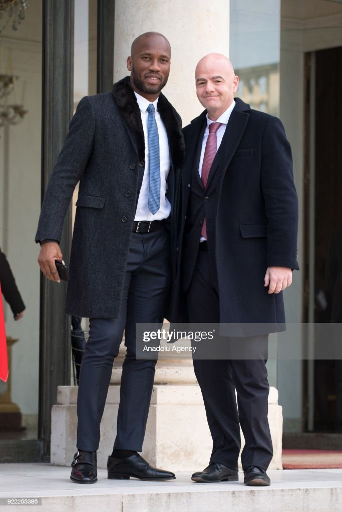 Former football player, Ivory Coast Didier Drogba (L) and President of FIFA, Gianni Infantino (R) arrive at Elysee Palace in Paris, France on February 21, 2018.