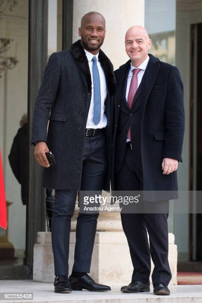 Former football player Ivory Coast Didier Drogba and President of FIFA Gianni Infantino arrive at Elysee Palace in Paris France on February 21 2018
