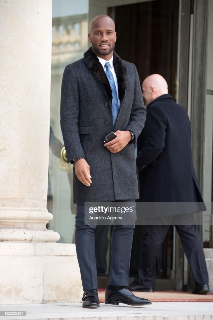Former football player, Ivory Coast Didier Drogba (L) arrives at Elysee Palace in Paris, France on February 21, 2018.