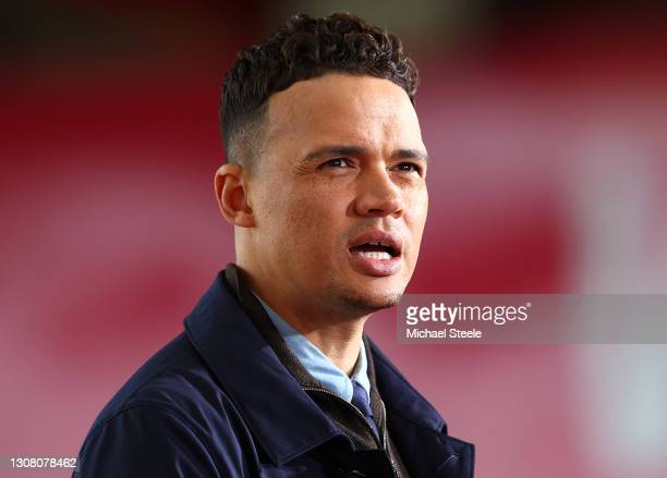 Former football player Jermaine Jenas looks on prior to The Emirates FA Cup Quarter Final match between Bournemouth and Southampton at Vitality...