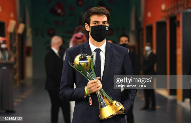 Former football player Kaka of Brazil carries the winner's trophy during the presentation ceremony after the FIFA Club World Cup Qatar 2020 Final...