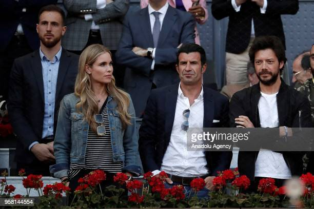 Former football player Luis Figo his wife Helen Svedin Atletico Madrid's goalkeeper Jan Oblak and Spanish actor Alvaro Morte watch the WTA men's...