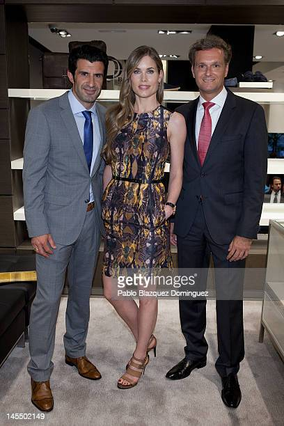Former football player Luis Figo model Helen Swedin and guest attend the opening of Hugo Boss Store at Calle Jorge Juan on May 31 2012 in Madrid Spain