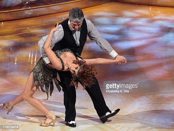Former football player Paolo Rossi and his dance partner Vicky Martin perform on the Italian TV show 'Ballando Con Le Stelle' at RAI Auditorium on...
