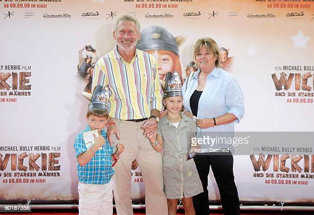 Former football player Paul Breitner and his wife Hildegard Breitner and grandchilds Louis and Lea attend the premiere of 'Vicky The Viking' at...