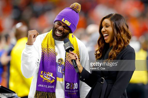 Former football player Randy Moss talks with the media prior to the College Football Playoff National Championship game between the Clemson Tigers...