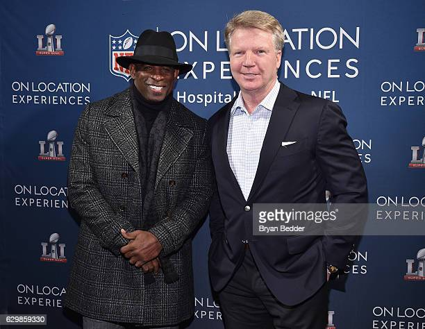 Former football players Deion Sanders and Phil Simms attend On Location Experiences' 51 Days To Super Bowl LI Celebration at STK Rooftop on December...