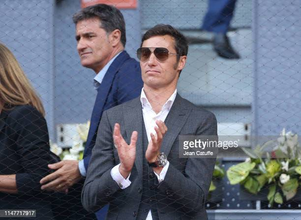 Former football players Ivan Helguera and above him Michel Gonzalez attend day 4 of the Mutua Madrid Open at La Caja Magica on May 7, 2019 in Madrid,...