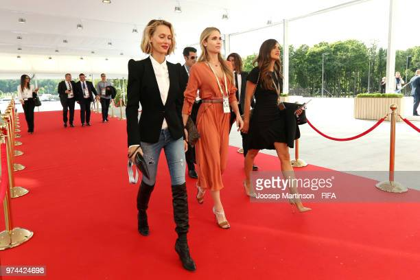 Former football players Luis Figo and Carles Puyol arrive at the stadium with their wives Vanesa Lorenzo and Daniela Svedin Figo prior to during the...