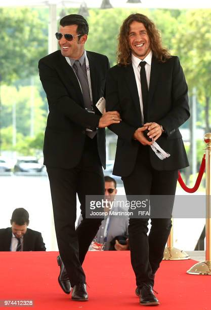 Former football players Luis Figo and Carles Puyol arrive at the stadium prior to during the 2018 FIFA World Cup Russia group A match between Russia...