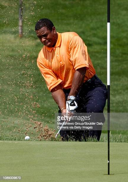 Former football star Amhad Rashad gets into trouble in the bunker of the 8th green of the Vista course at the Sun Microsystems John Elway Celebrity...