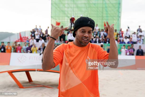 Former football star Ronaldinho celebrates as he plays Teqball as The International Teqball Federation celebrate one year until the Sanya Asian Beach...