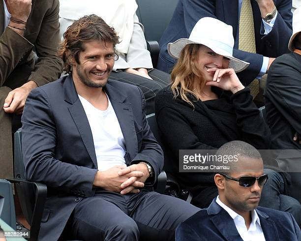 Former Football World Champion Bixente Lizarazu And French actress Claire Keim watch the action during the Men's Singles Final match Robin Soderling...