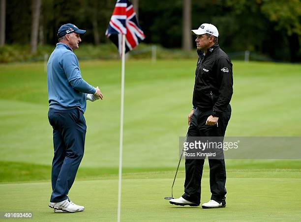 Former footballer Alan McInally and Lee Westwwod of England in action during the proam event prior to the British Masters at Woburn Golf Club on...