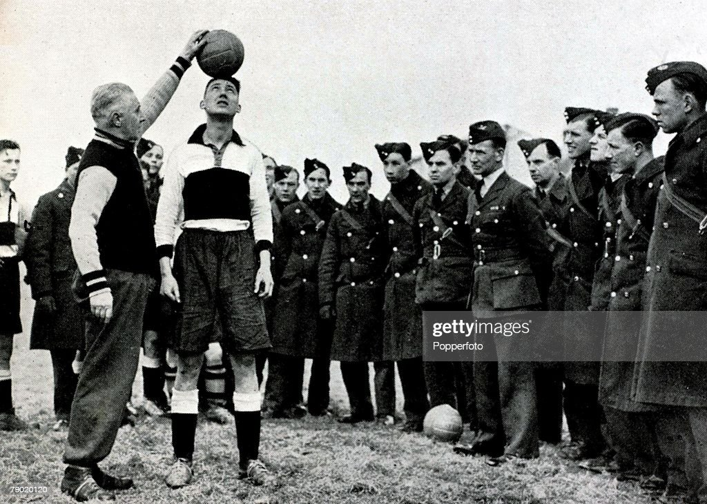 World War II. Sport. Football. March 1940. Aston Villa Manager Jimmy Hogan in France demonstrating headwork to R.A.F.troops stationed there. : News Photo