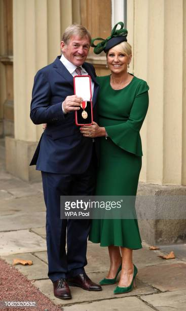 Former footballer and manager Sir Kenny Dalglish poses with his wife Marina Dalglish after being knighted at an investiture ceremony at Buckingham...
