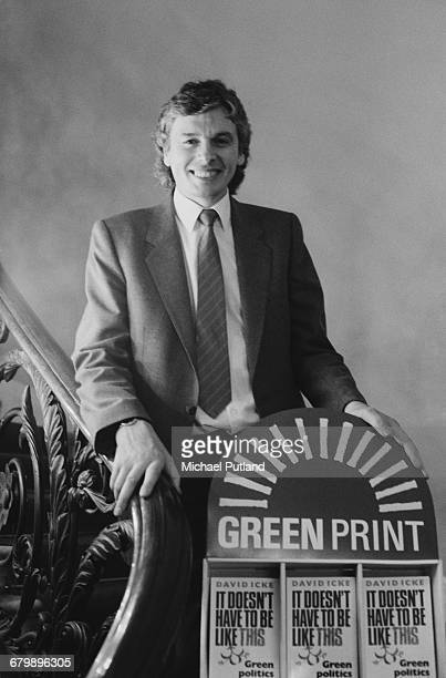 Former footballer and sports broadcaster David Icke with a promotional display for his book , 'It Doesn't Have To Be Like This: Green Politics...