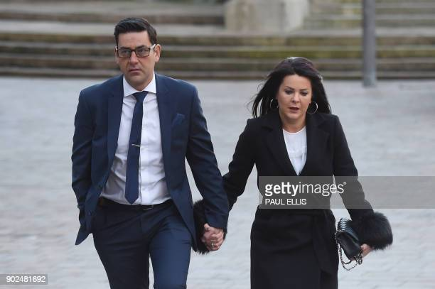 Former footballer and victim of abuse Andy Woodward arrives at court with his partner Zelda in Liverpool on January 8 2018 on the first day of the...