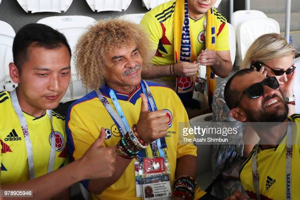 Former footballer Carlos Valderrama poses for photographs prior to the 2018 FIFA World Cup Russia group H match between Colombia and Japan at...