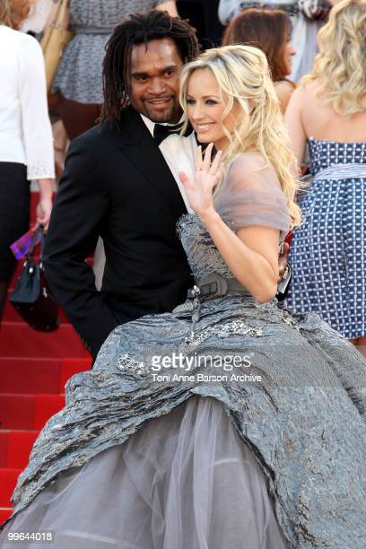 Former footballer Christian Karembeu and model Adriana Karembeu attend the premiere of 'Biutiful' held at the Palais des Festivals during the 63rd...