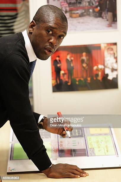Former footballer, Clarence Seedorf signs a map of the newly opened Clarence Seedorf Playgrpund during the Laureus European Workshop and Project...