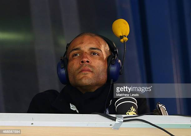 Former footballer Clarke Carlisle looks on during the Barclays Premier league match West Bromwich Albion and Queens Park Rangers at The Hawthorns on...