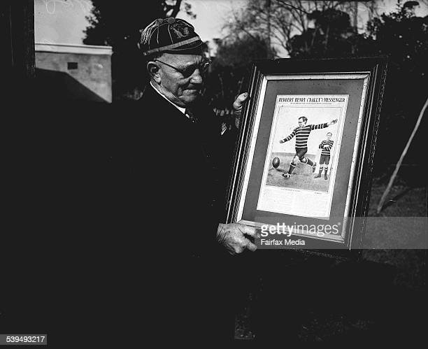Former footballer Dally Messenger holding a framed photograph of himself in his playing days on 29 July 1950 SUN NEWS Picture by STAFF