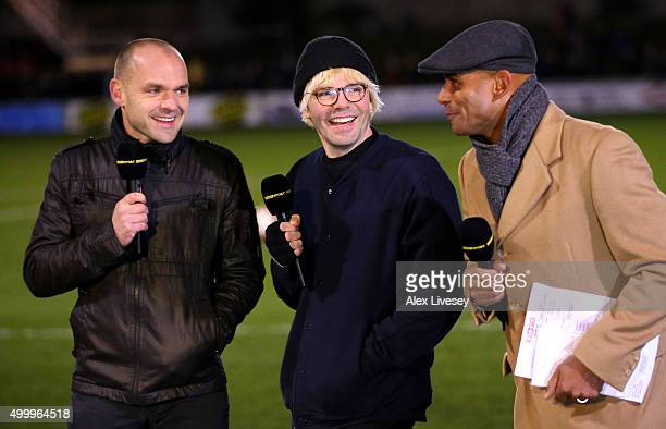 Former footballer Danny Murphy Tim Burgess lead singer of The Charlatans and former footballer Trevor Sinclair talk at half time on the BBC during...